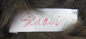 Scaasi Knitted Sheared Rex Rabbit Scarf Label image